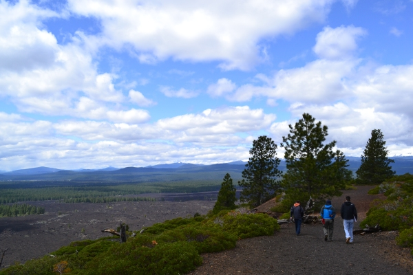 Students hike the rim trail around Lava Butte for a view of some of the youngest lava flows from Newberry and a discussion about Newberry's eruptive history.