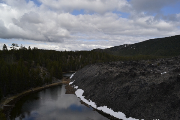 View from the Big Obsidan Flow, which still has patches of deep snow in some place along the hiking trails.