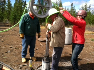 When we removed the low-flow pump from this well, we also had to lift out the seismometer. After detaching the pump from the cables that go to the surface we replaced the seismometer, which will remain in the well for the winter.