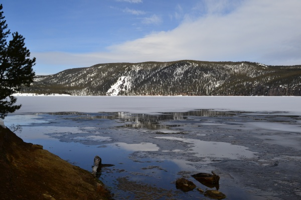 Frozen over except where hot springs bubble to the surface and warm the water, East Lake on Newberry Volcano quietly waits for summer visitors to return.