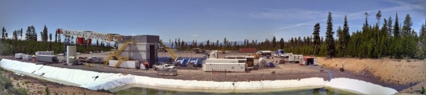 Panoramic view of the injection well pad at Newberry EGS Demonstration during summer activities at the site. The drill rig (center- during assembly) arrived in early August, and completed required well upkeep on schedule.