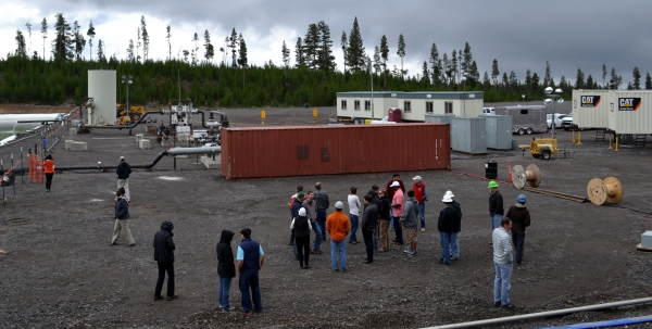 As part of the Geothermal Resource Council's Newberry fieldtrip, 24 visiting scientists, government officials, journalists, professors and others interested in geothermal research visited the Newberry EGS Demonstration site in late September while stimulation was underway.